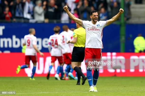 Mergim Mavraj of Hamburg celebrates the opening goal during the Bundesliga match between Hamburger SV and TSG 1899 Hoffenheim at Volksparkstadion on...