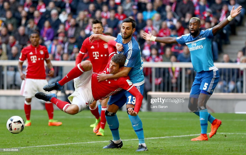 Mergim Mavraj of Hamburg challenges Thomas Mueller of Bayern Muenchen during the Bundesliga match between Bayern Muenchen and Hamburger SV at Allianz Arena on February 25, 2017 in Munich, Germany.