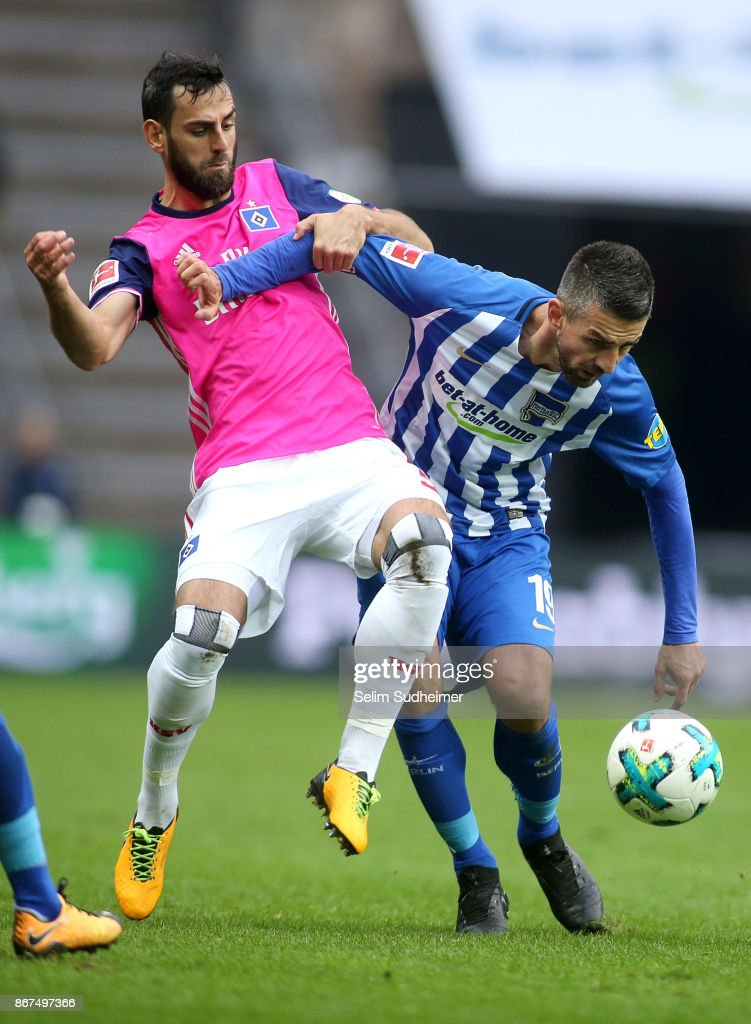 Mergim Mavraj of Hamburger SV (L) fights for the ball with Vedad Ibisevic of Hertha BSC during the Bundesliga match between Hertha BSC and Hamburger SV at Olympiastadion on October 28, 2017 in Berlin, Germany.