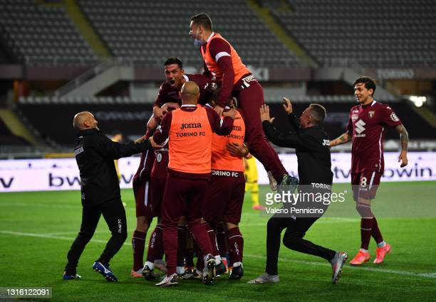 Mergim Vojvoda of Torino FC celebrates with team mates after scoring their side's first goal during the Serie A match between Torino FC and Parma...