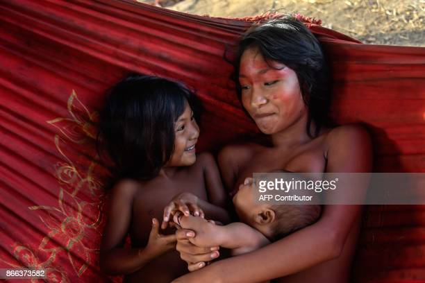 Meri Waiapi cares children at the Waiapi indigenous reserve in Amapa state in Brazil on October 14, 2017. The tiny Waiapi tribe is resisting moves by...