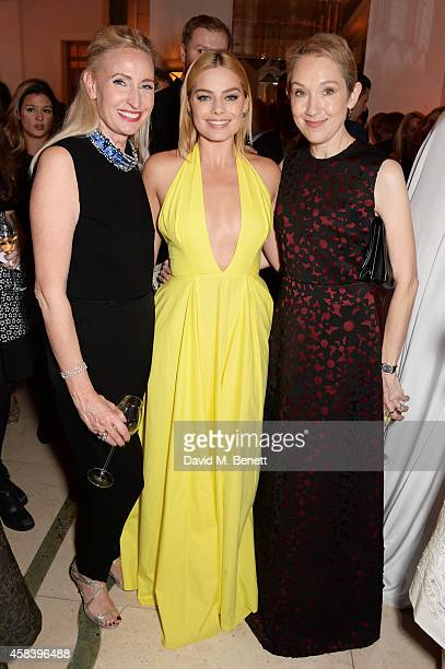 Meribeth Parker Margot Robbie and Justine Picardie Editorinchief of Harper's Bazaar UK attend the Harper's Bazaar Women Of The Year awards 2014 at...