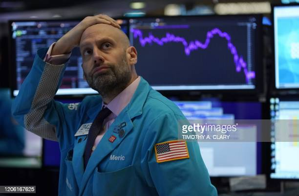 Meric Greenbaum, Designated Market Maker IMC financial looks up at the board before the opening bell right before trading halted on the New York...