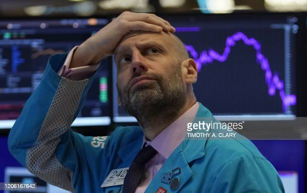 TOPSHOT Meric Greenbaum Designated Market Maker IMC financial looks up at the board before the opening bell right before trading halted on the New...