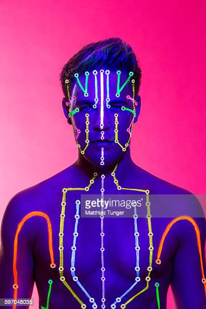 Meridians painted on the head of a man