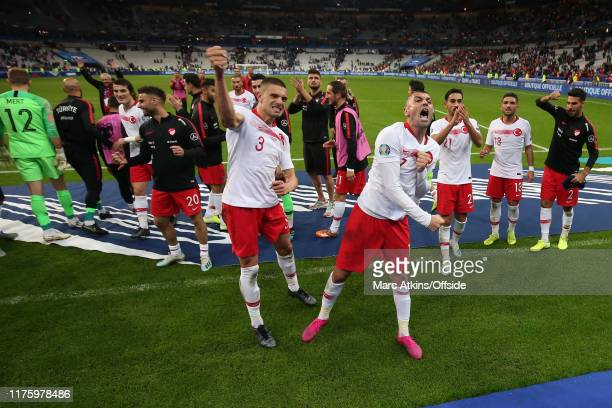 Merih Demiral and Burak Yilmaz of Turkey celebrate with team mates after the 11 draw during the UEFA Euro 2020 qualifier between France and Turkey on...