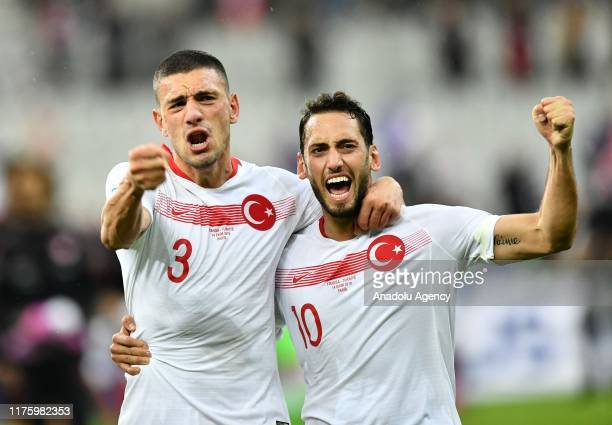 Merih Demiral and Hakan Calhanoglu of Turkey celebrate after the UEFA EURO 2020 qualifier Group H soccer match between France and Turkey at Stade de...