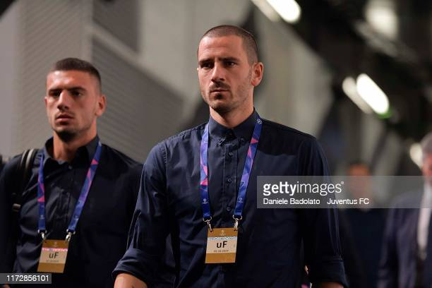 Merih Demiral and Leonardo Bonucci of Juventus arrive at the stadium before the UEFA Champions League group D match between Juventus and Bayer...