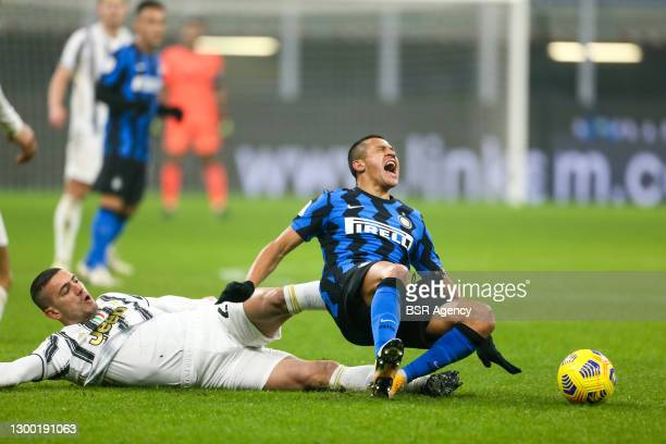 Merih Demiral of Juventus, Alexis Sanchez of Internazionale during the Coppa Italia match between Internazionale and Juventus at San Siro Stadium on...