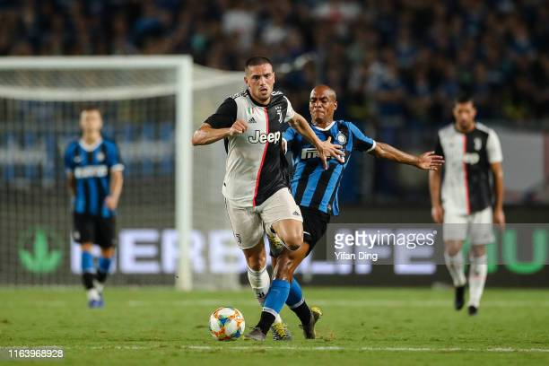 Merih Demiral of Juventus and Joao Mario of FC Internazionale in aaction during the International Champions Cup match between Juventus and FC...