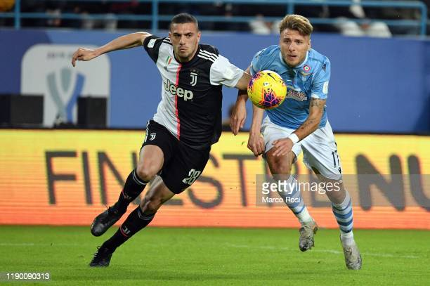 Merih Demiral of Juventus competes for the ball with Ciro Immobile of SS Lazio during the Italian Supercup match between Juventus and SS Lazio at...