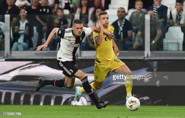 Merih Demiral of Juventus competes for the ball with Darko Lazovic of Hellas Verona during the Serie A match between Juventus and Hellas Verona at...