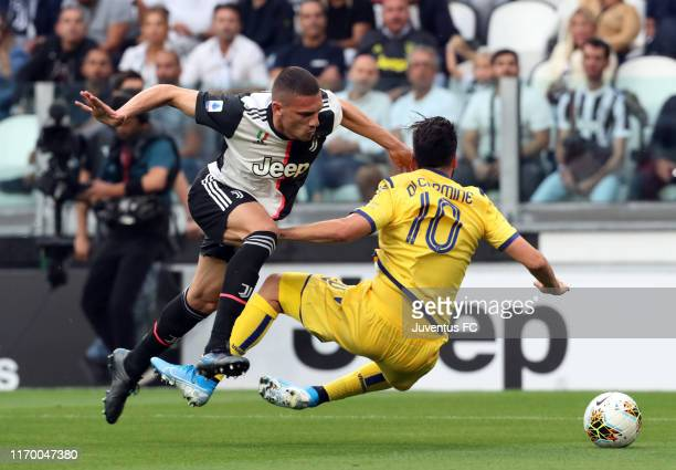 Merih Demiral of Juventus competes for the ball with Samuel Di Carmine of Hellas Verona during the Serie A match between Juventus and Hellas Verona...