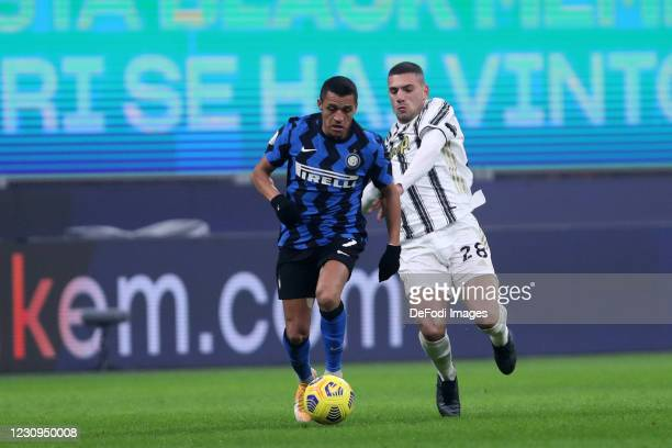 Merih Demiral of Juventus FC and Alexis Sanchez of FC Internazionale battle for the ball during the Coppa Italia semi-final match between FC...