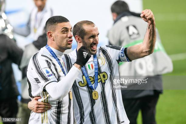 Merih Demiral of Juventus FC and Giorgio Chiellini of Juventus FC celebrate after winning the Italian Super Cup Final match between FC Juventus and...