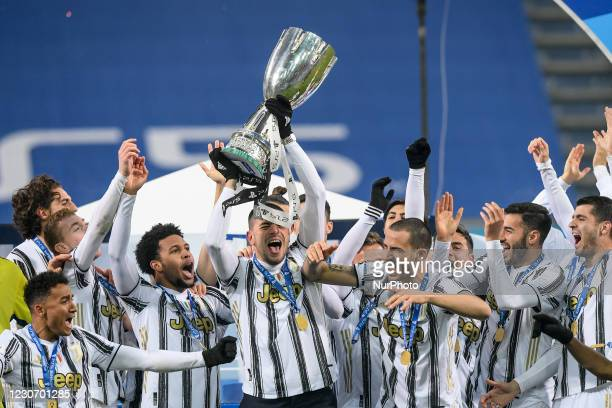 Merih Demiral of Juventus FC and his teammates celebrate after winning the Italian Super Cup Final match between FC Juventus and SSC Napoli at the...