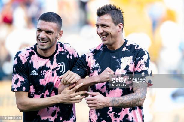 Merih Demiral of Juventus FC jokes with Mario Mandzukic of Juventus FC during the Serie A match between Parma Calcio 1913 and Juventus at Stadio...