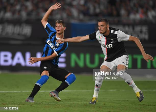 Merih Demiral of Juventus fights for the ball with Sebatiano Esposito of FC Internazionale during the International Champions Cup match between...
