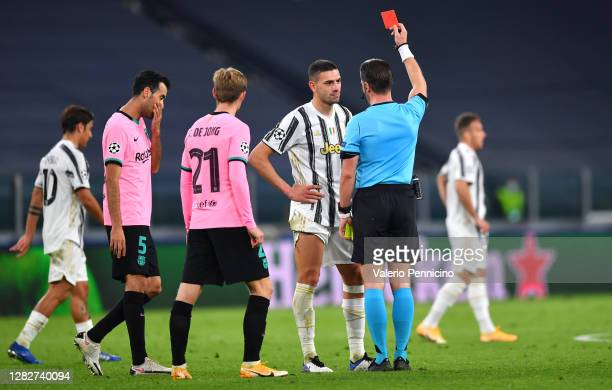 Merih Demiral of Juventus is shown a red card by referee Danny Makkelie after receiving a second yellow card during the UEFA Champions League Group G...