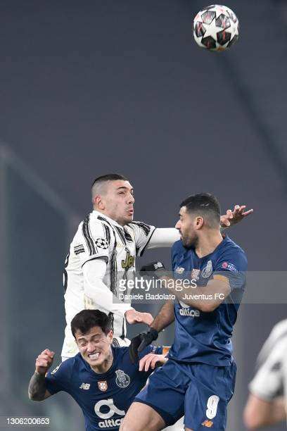 Merih Demiral of Juventus jumps for the ball against Otavio and Mehdi Taremi of FC Porto during the UEFA Champions League Round of 16 match between...