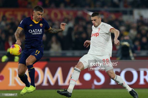 Merih Demiral of Juventus scores the opening goal during the Serie A match between AS Roma and Juventus at Stadio Olimpico on January 12 2020 in Rome...