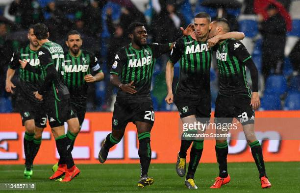 Merih Demiral of Sassuolo celebrates after scoring the opening goal with teammates during the Serie A match between US Sassuolo and Chievo at Mapei...