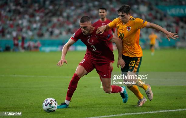 Merih Demiral of Turkey battles for possession with Daniel James of Wales during the UEFA Euro 2020 Championship Group A match between Turkey and...