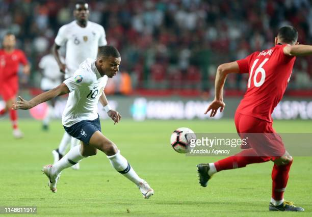 Merih Demiral of Turkey in action against Kylian Mbappe of France during the UEFA European Qualifying Group H match between Turkey and France for...