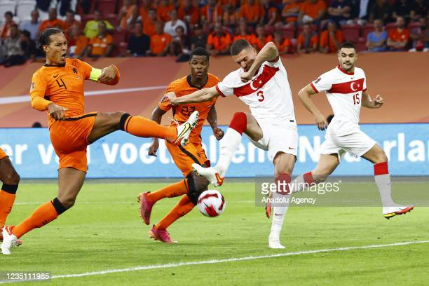 Merih Demiral of Turkey in action against Virgil van Dijk of Netherlands during the 2022 FIFA World Cup Qualifiers Group G soccer match between...