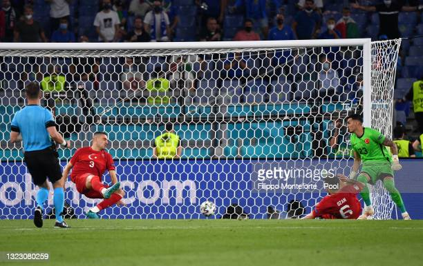 Merih Demiral of Turkey scores an own goal for Italy's first goal during the UEFA Euro 2020 Championship Group A match between Turkey and Italy at...