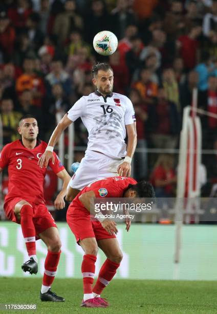 Merih Demiral of Turkey vies with Kaan Ayhan of Albania during the UEFA Euro 2020 Qualifying round Group H group match between Turkey and Albania at...