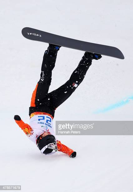 Merijn Koek of the Netherlands crashes during the Men's Para Snowboard Cross Standing on day seven of the Sochi 2014 Paralympic Winter Games at Rosa...