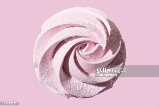 meringue marshmallow zephyr on pink background. trendy top view dessert image. close-up of pink sweet homemade zephyr. - cream dairy product stock pictures, royalty-free photos & images