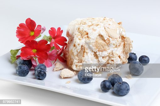 Meringue, sponge cake and blueberries dessert