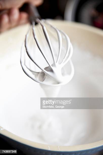 meringue with a whisk - meringue stock pictures, royalty-free photos & images