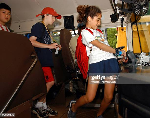 Merion Elementary School student scans her Air Clic card as she arrives at the school May 19 2004 in Lower Merion Pennsylvania The Lower Merion...