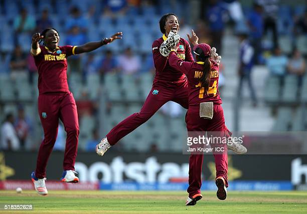 Merissa Aguilleira of the West Indies celebrates victory with team mates during the Women's ICC World Twenty20 India 2016 Semi Final match between...