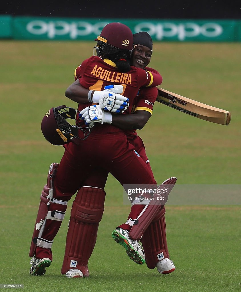 Merissa Aguilleira of the West Indies congratulates Deandra Dottin on her century during the ICC Women's World Cup 2017 match between West Indies and Pakistan at Grace Road on July 11, 2017 in Leicester, England.