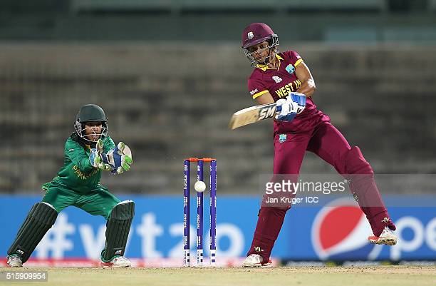 Merissa Aguilleira of the West Indies hits out with Sidra Ameen of Pakistan looking on during the Women's ICC World Twenty20 India 2016 match between...