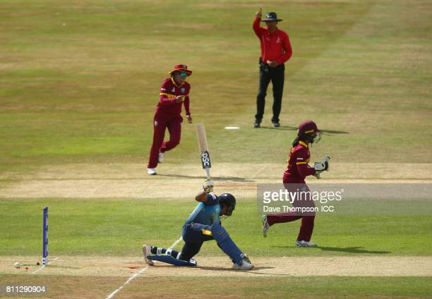 Merissa Aguilleira of West Indies celebrates after stumping Chamari Athapaththu of Sri Lanka during the ICC Women's World Cup match between West...