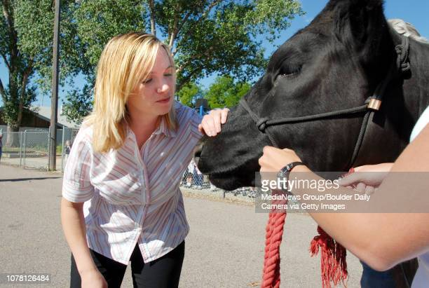 Meritor Academy principal Vanessa Ewing kisses Hefner a 1 1/2 yearold steer from the Wild West Ranch in Arvada at the school on Friday The 'kiss a...