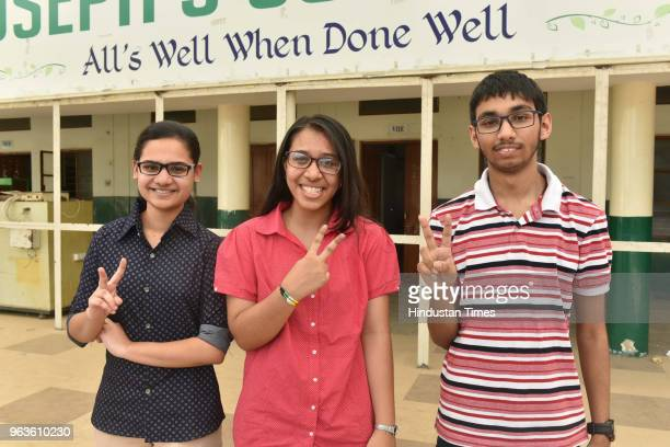 Meritorious students of St Josephs CoEd school Arohi Jain Tanisha Jain and Swapnil Shivam after getting equal 978 % marks celebrate their success in...