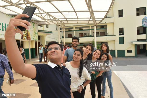 Meritorious students of St Josephs CoEd school celebrate their success in CBSE class12th exam results on May 26 2018 in Bhopal India A total of 11306...