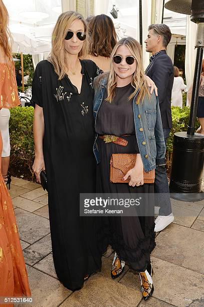Meritt Elliott and Emily Current attend NETAPORTER Celebrates Women Behind The Lens at Chateau Marmont on February 26 2016 in Los Angeles California