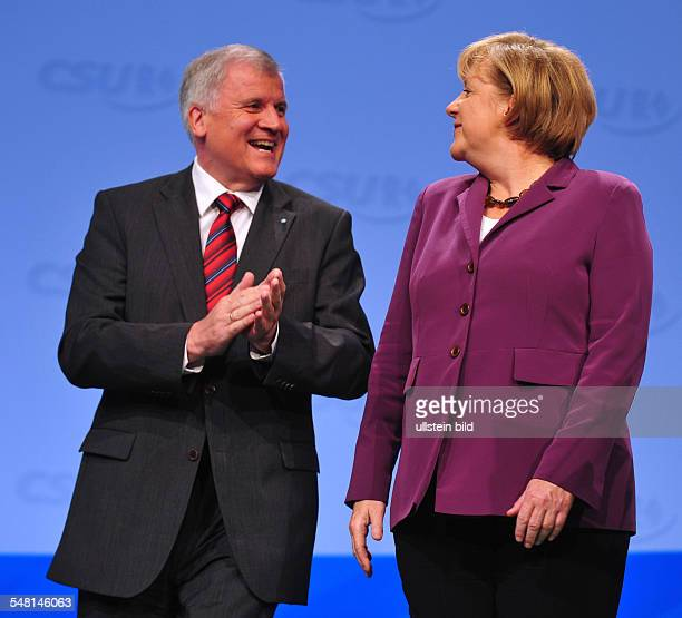 Merkel, Angela - Politician, CDU, Germany, Federal Chancellor - and Horst Seehofer at the CSU party congress in Munich