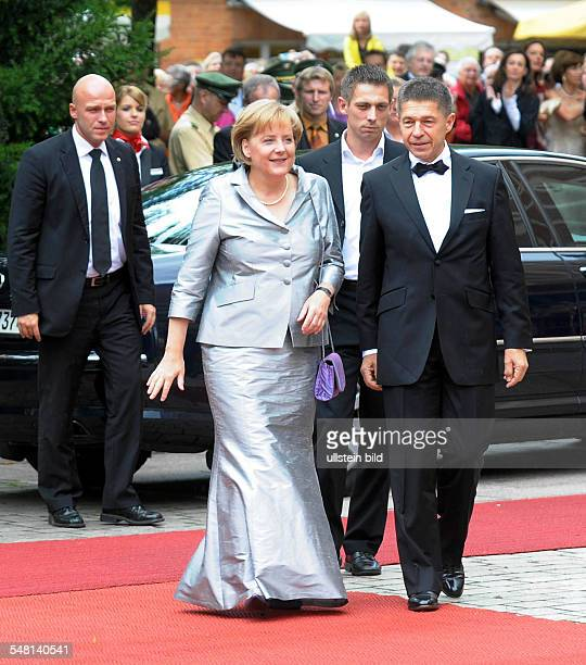 Merkel Angela Politician CDU Germany Federal Chancellor at the Bayreuth Festival with her husband Joachim Sauer and stepson Daniel Sauer