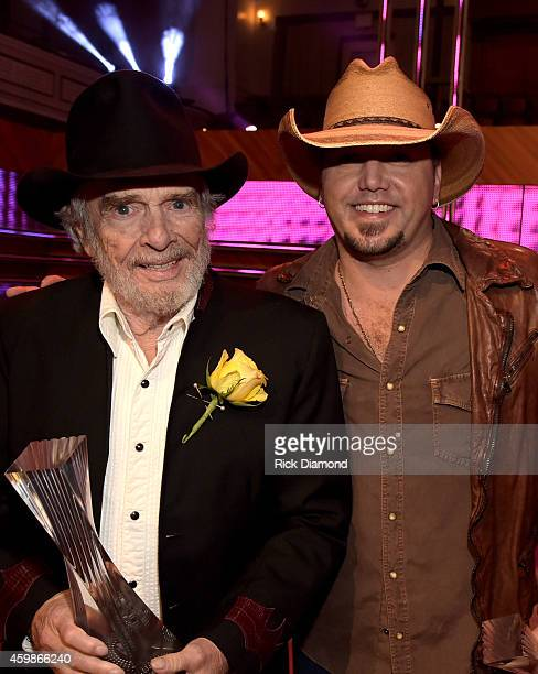 Merle Haggard and Jason Aldean at the 2014 CMT Artists Of The Year at the Schermerhorn Symphony Center on December 2 2014 in Nashville Tennessee