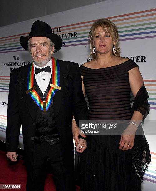Merle Haggard and Theresa Ann Lane pose for photos during the 33rd Annual Kennedy Center Honors at the Kennedy Center Hall of States on December 5...