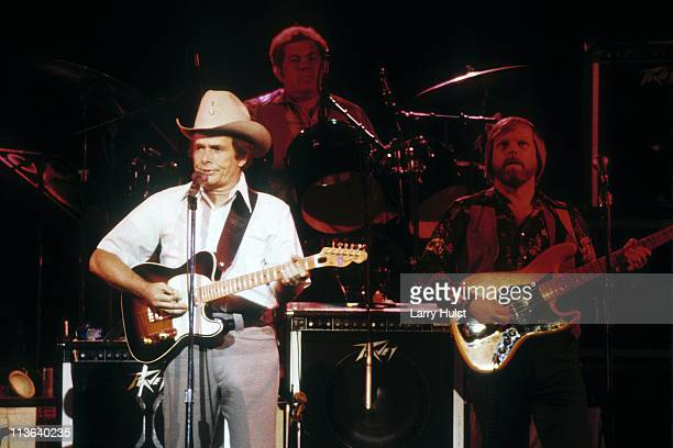 Merle Haggard Biff Adam and Dennis Hromek performing with 'Merle Haggard and the Strangers' at The Cow Palace in Daly City California on October 6...