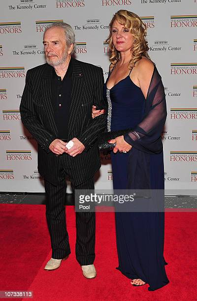 Merle Haggard one of the 2010 Kennedy Center honorees arrives with his wife Theresa Ann Lane for the formal artist's dinner for the Kennedy Center...